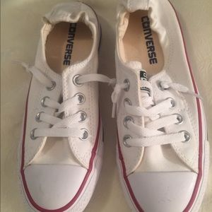 Boy or girls converse tennis shoes.